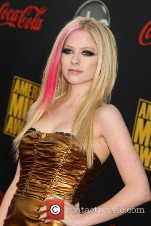 Lavigne Sued Over Girlfriend