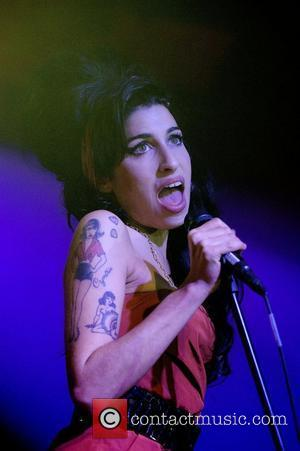 * WINEHOUSE'S HUSBAND TO SPEND CHRISTMAS IN JAIL AMY WINEHOUSE's husband BLAKE FIELDER-CIVIL has been refused bail and remains in...