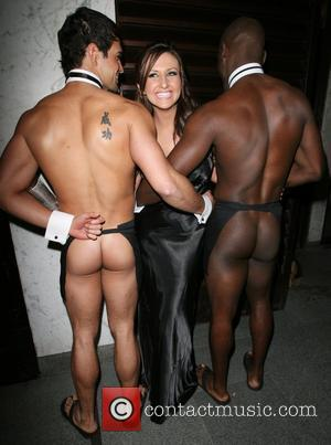 Amy Alexandra poses with male models outside Embassy Club, for her