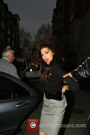 Amy Winehouse Is ushered past photographers as she arrives at a clinic in Marylebone. The troubled singer was filmed taking...