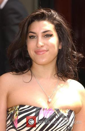 Winehouse To Enter Rehab After New Year