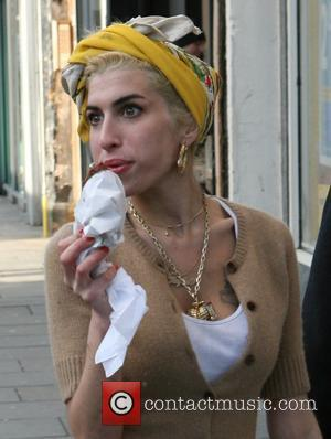 Winehouse's Father-in-law Urges Fans To Boycott Her Music