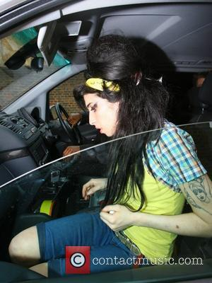 Amy Winehouse leaving home to go to Pentonville prison to visit her incarcerated husband Blake London, England - 21.04.08