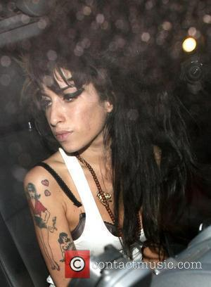 Winehouse Divorce Will Have To Wait