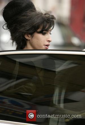 Winehouse: 'I Feel Sorry For Beckham'