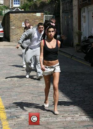Winehouse Axed Gigs After Love Split