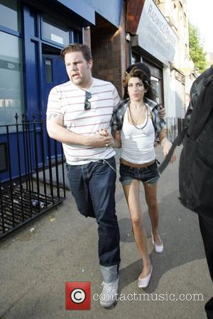 Amy Winehouse spotted with a mystery man visiting a clinic near her home in North London. London, England - 13.05.08