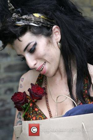 Amy Winehouse leaving her house after receiving flowers on her one year wedding anniversary  London, England - 18.05.08