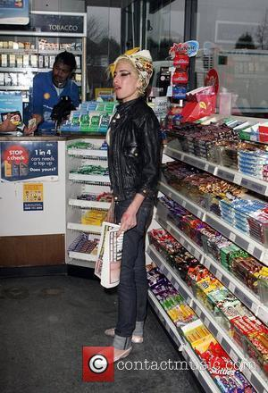 Amy Winehouse sporting her new blonde look, buying snacks from a petrol station
