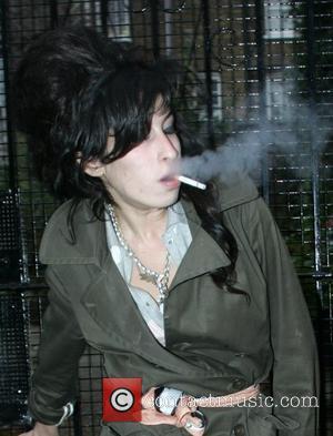 Winehouse Demands Champagne, Vodka + Pizza Backstage