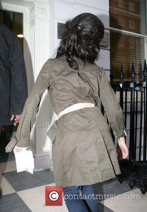 Winehouse's Husband Charged
