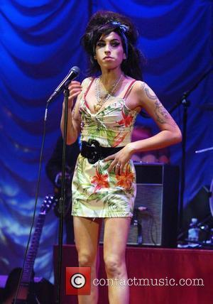 Amy Winehouse performing live at the Hammersmith Apollo London, England - 24.11.07
