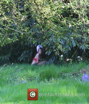 Amy Winehouse Takes time out from the studio to have a walk around, when she spots some photographers spying on...