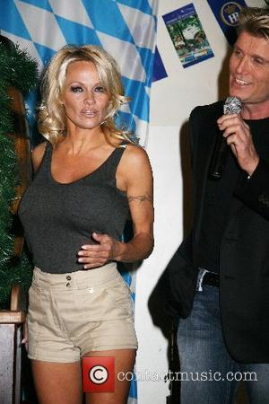 Pamela Anderson and Hans Klok Pamela Anderson And Hans Klok Kick Off Oktoberfest Las Vegas, Nevada - 05.10.07