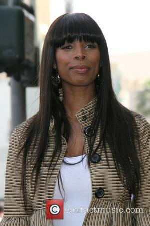 Tasha Smith Angela Bassett honoured with the 2,358th Star on the Hollywood Walk Of Fame on Hollywood Boulevard Los Angeles,...