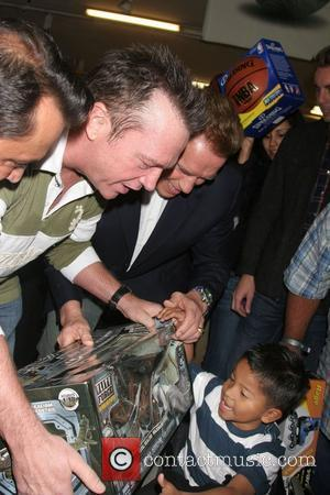 Tom Arnold and California Governor, Arnold Schwarzenegger The 26th Annual 'Miracle On 1st Street' toy giveaway at Hollenbeck Youth Center...