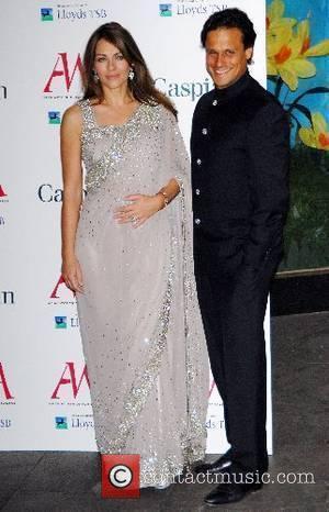 Elizabeth Hurley & husband Arun Nayar Asian Women Of Achievement Awards held at London Hilton - Arrivals London, England -...