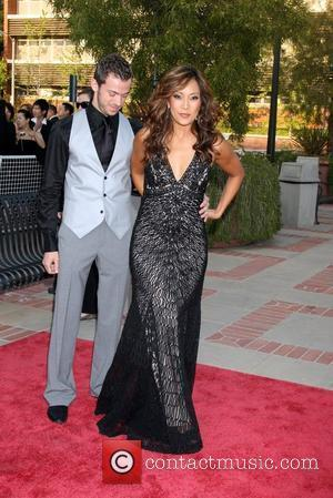 Carrie Ann Inaba and Guest The 2008 JC Penny Asian Excellence Awards held at the Royce Hall, UCLA campus. Los...