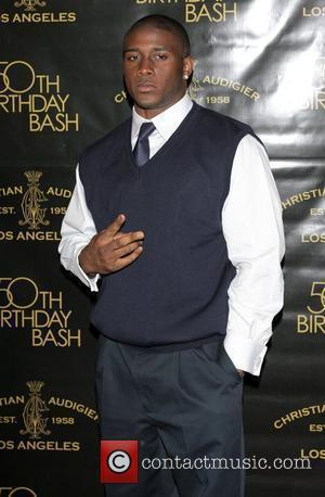 Reggie Bush Christian Audigier 50th birthday party at the Petersen Automotive museum in Hancock park - arrivals Los Angeles, California...