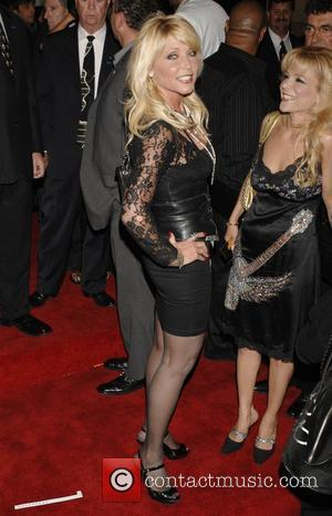Pamela Bach Christian Audigier 50th birthday party at the Petersen Automotive museum in Hancock park - arrivals Los Angeles, California...