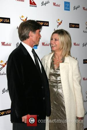 John Easterling and Olivia Newton-John The G'Day USA Australia.com Black Tie Gala Grand Ballroom, Hollywood and Highland Los Angeles, California...