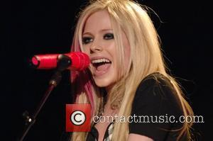 Lavigne Shoots Own Album Cover With Husband Whibley