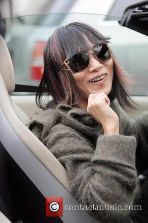 Bai Ling  arrives outside the Platinum Equity World Headquarters and stops for pictures. Beverly Hills, California - 08.01.08