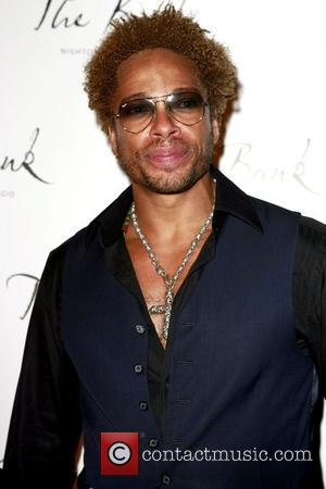 Dourdan Plays Down Paparazzo Clash