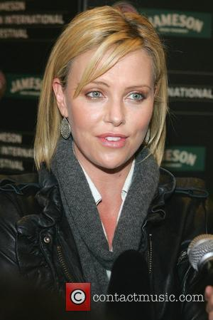 Charlize Theron Photos & Pics