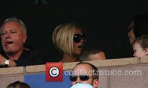 Beckham Downplays Breast Size