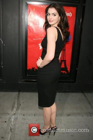 Hathaway Tastes Paparazzi Craziness On Film Set