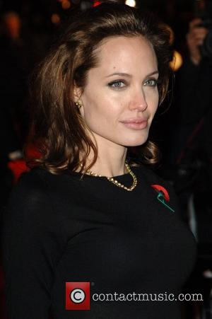 Jolie + Pitt To 'Wed' In Las Vegas On Wednesday
