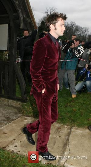 David Tennant arrives at the wedding of Billie Piper and Laurence Fox at the Parish Church of St. Mary in...
