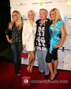 Kendra Wilkinson, Holly Madison and Hugh Hefner
