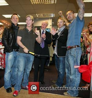 Mikey Graham, Stephen Gatley, Ronan Keating and Shane Lynch from Boyzone attend the opening of Keith Duffy's father's shop 'Plus...