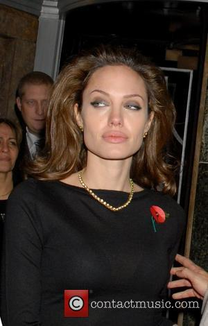 Jolie: 'My Travels Don't Make Me An Irresponsible Mum'
