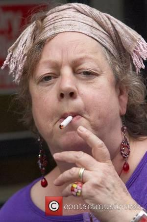 Jo Brand  seen laughing and chatting with Mark Lamarr in West London as they both lay into a pack...