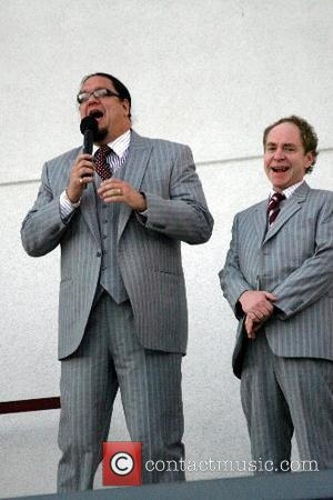Penn Jillette and Teller of Penn & Teller To celebrate Virgin America Airlines inaugural flight Sir Richard Branson repels off...