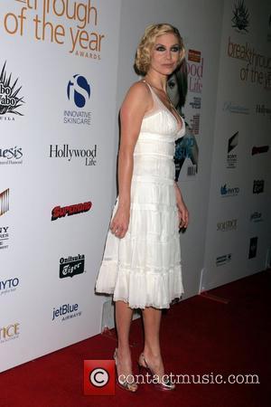 Mitchell's 'Lucky' Dumpster Shirt Landed Her Jolie Film