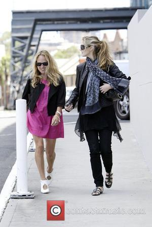 Delta Goodrem and Brian McFadden walk to Delta's apartment on the Sydney Harbour waterfront with a friend, after enjoying a...