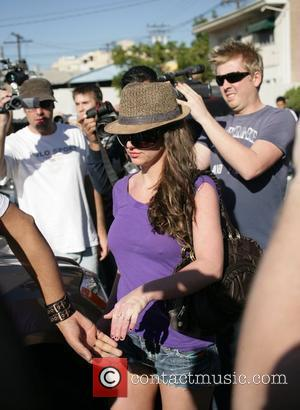 Britney Spears in trilby hat and cut-off jeans with her new man, photographer Adnan Ghalib shopping at Rite Aid Los...