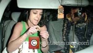 Britney Spears and Adnan Ghalib sitting in his car, as the car had a flat tyre Los Angeles, California -...