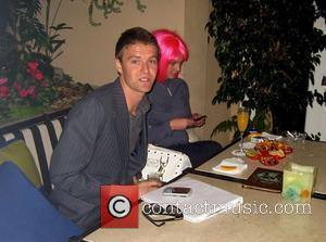 Britney Spears, Wearing A Pink Wig and Takes A Break With Her Realtor At The Four Seasons Hotel