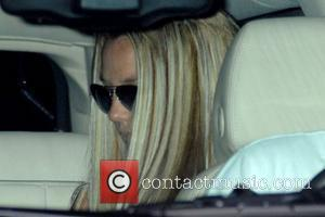 Spears Flashes At Paparazzi