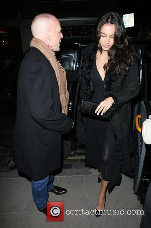 Bruce Willis, His New Girlfriend Emma Heming Arrive Back At Their Hotel and Having Had Had Dinner At The Ivy Restaurant.