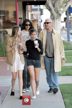 Bruce Willis, her girlfriend, daughter Tallulah Belle Willis pick up coffee at Starbucks and walk along Robertson Boulevard to go...
