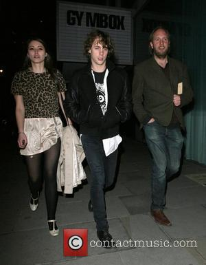 Johnny Borrell of Razorlight, and a mystery brunette leaving Bungalow 8 nightclub. London, England - 10.04.08