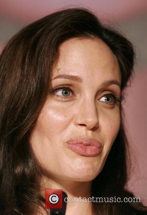 Jolie Back In Africa