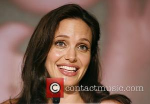 Jolie: 'Jet-setting Lifestyle Is Hard'