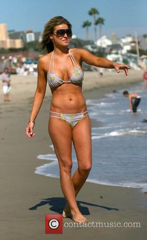 Carmen Electra frolicks on Malibu beach. The 'I Love Candy' star changed into two different bikinis in an afternoon Malibu,...
